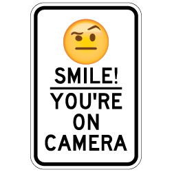 Smile! You're On Camera Signs for Sale with Raised Eyebrow Emoji - 12x18 - Made with Reflective Rust-Free Heavy Gauge Durable Aluminum available online for shipping from STOPSignsAndMore.com
